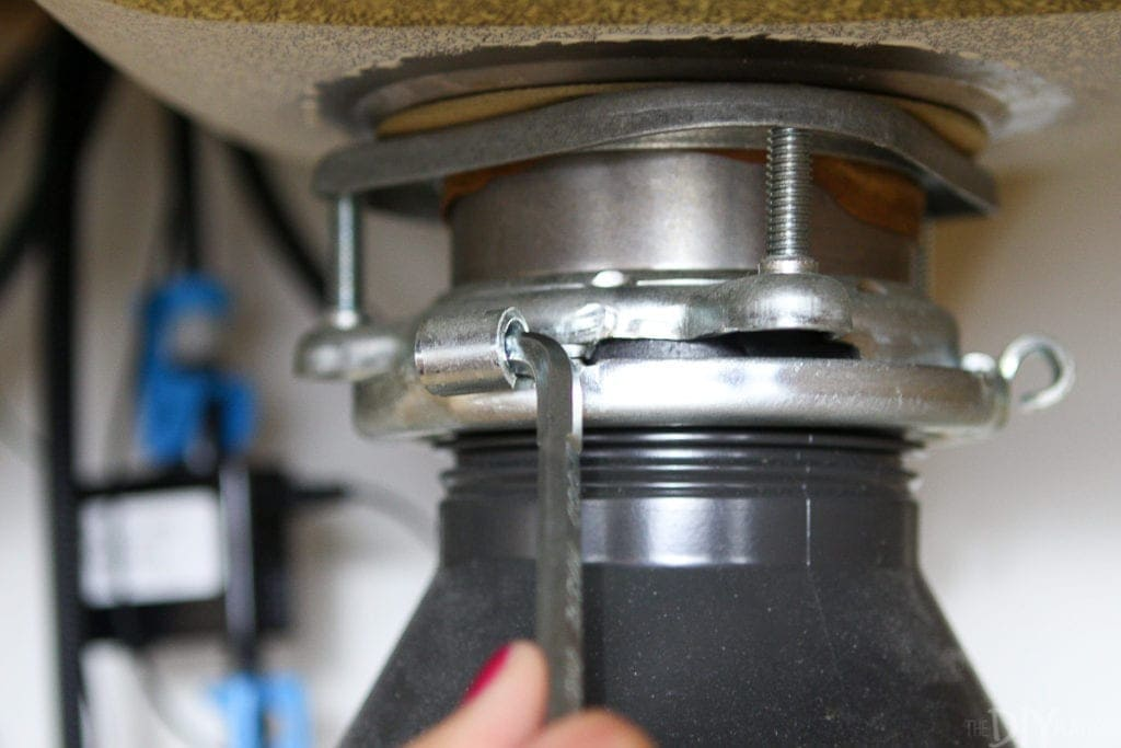 Use a wrenchette to remove old garbage disposal