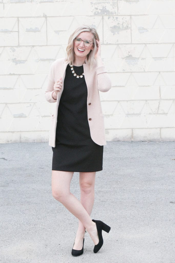 A black sheath dress with a camel blazer on top
