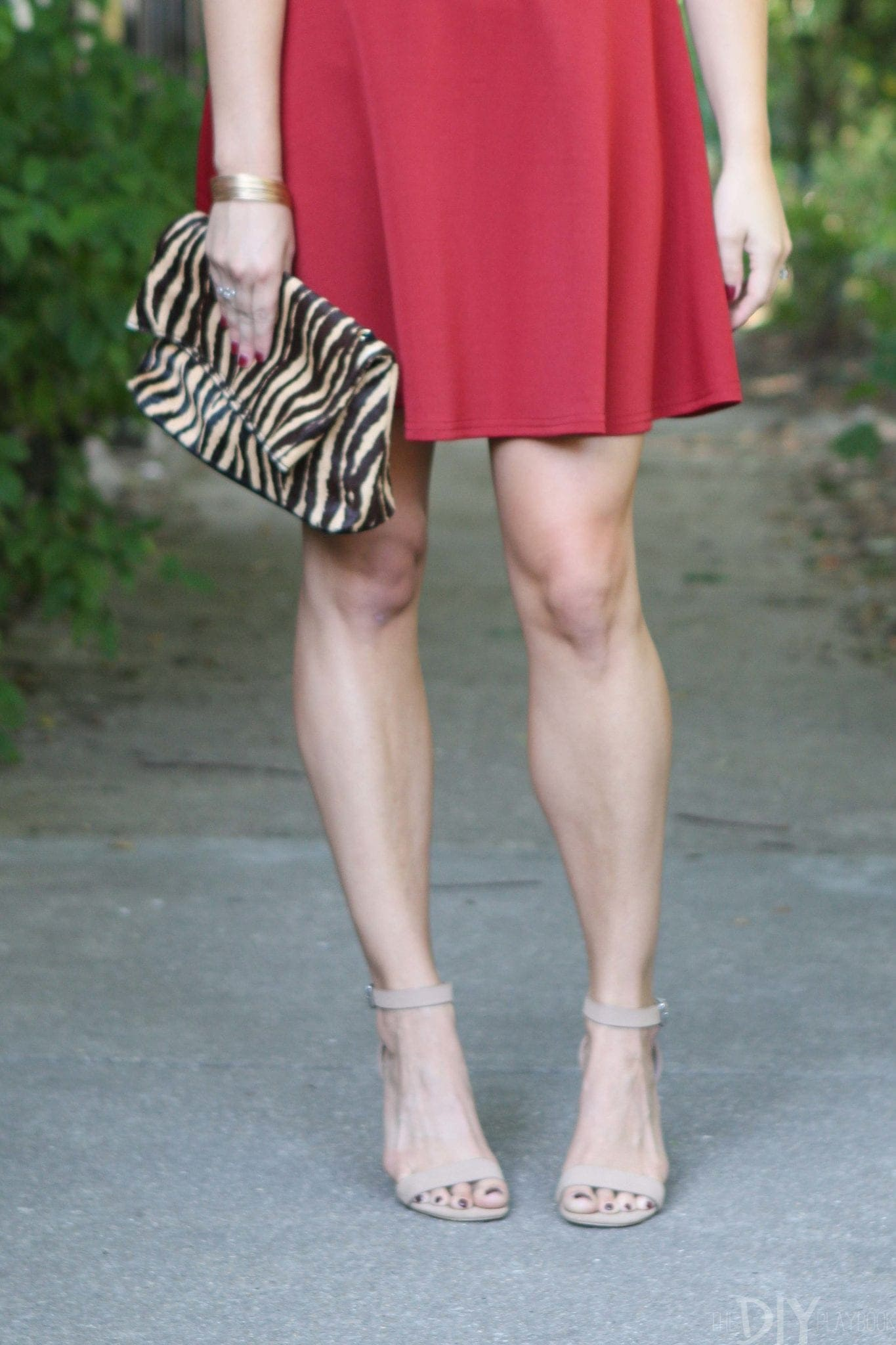 Nude strappy heels with a leopard clutch