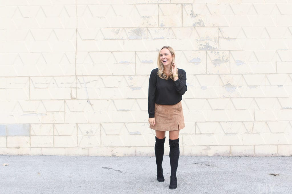 A tan suede skirt with a black blouse