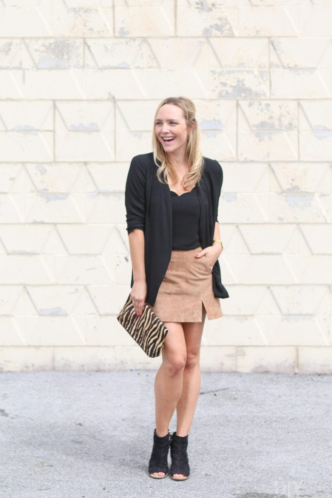 A black camisole with a tan skirt