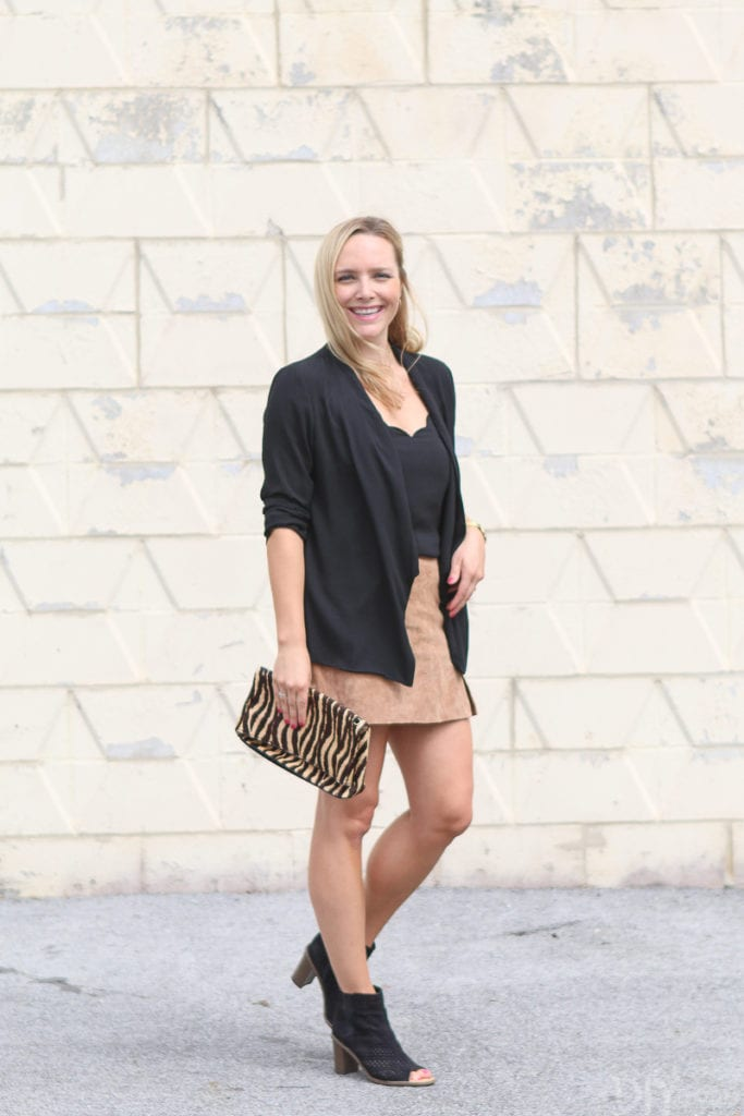 Wearing a suede skirt with a black camisole and blazer