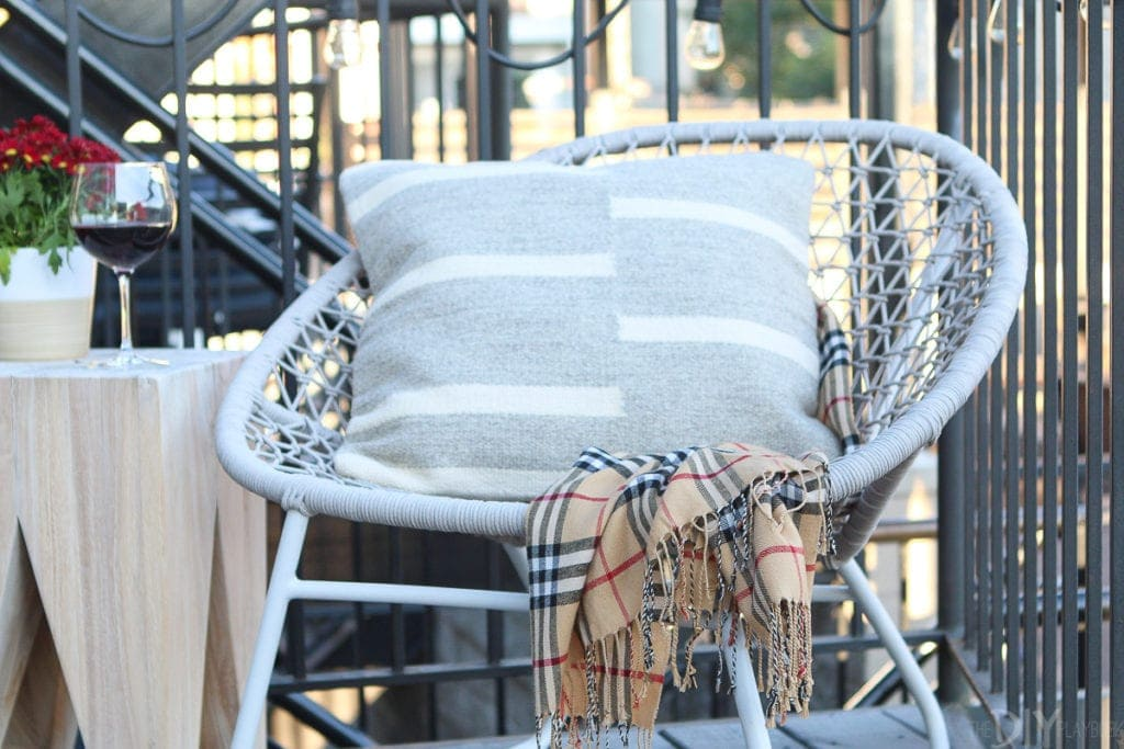 Use a fall scarf to add pattern to a chair or sofa