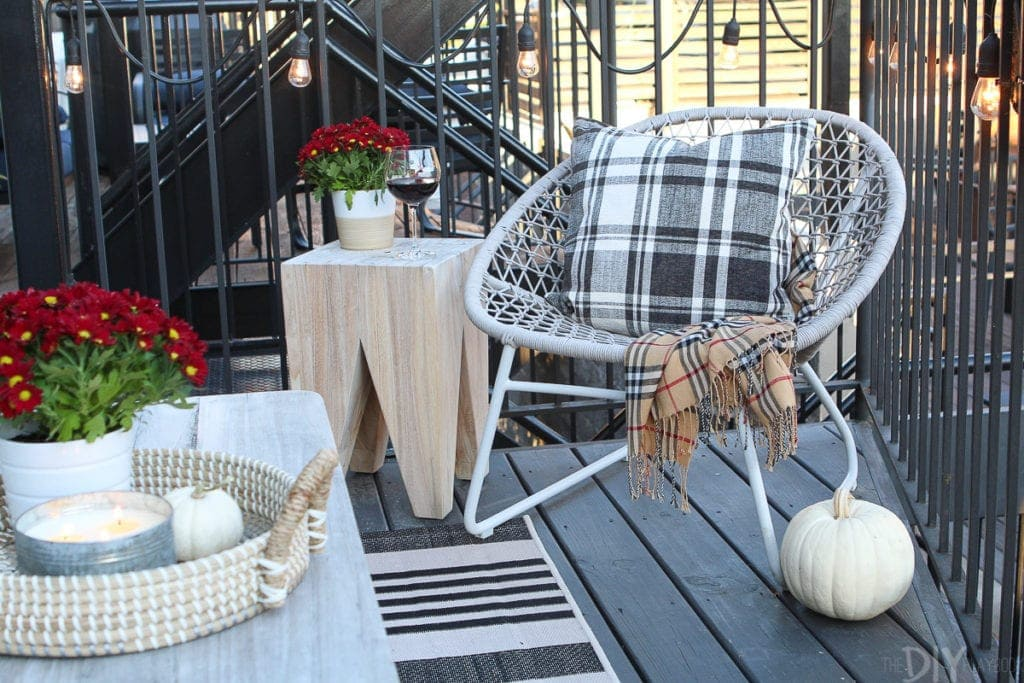 Adding plants and blankets to a fall patio