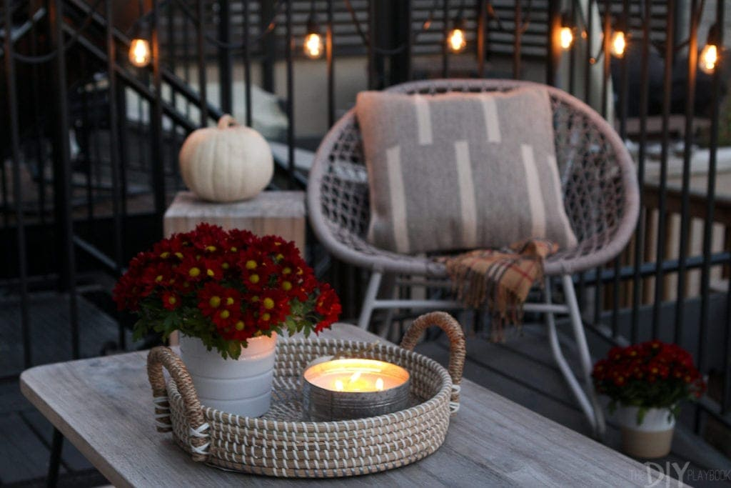 Light candles on your patio to keep bugs away and set the mood