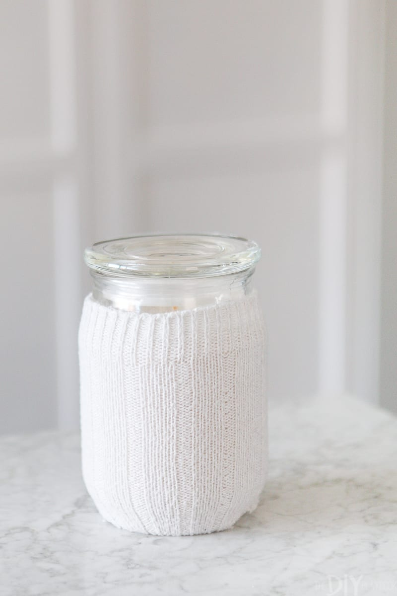 Covering an ugly candle label using a wool sock cover
