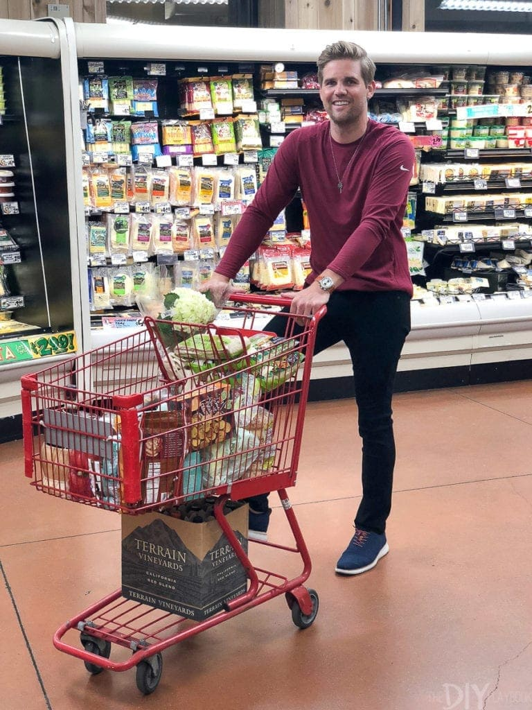 Finn pushing grocery cart at trader joe's