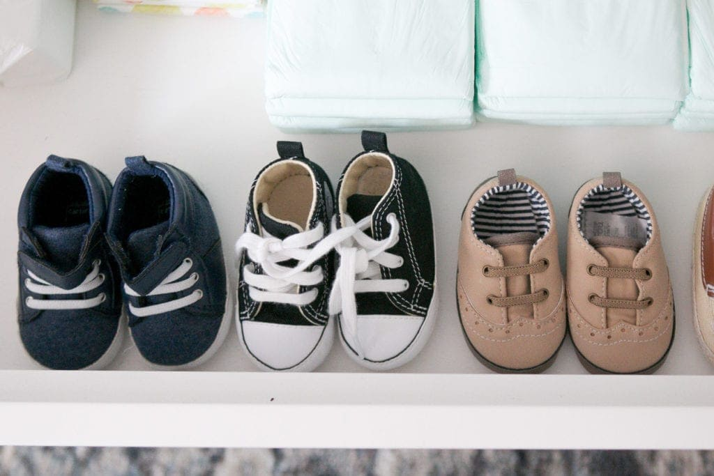organizing baby shoes in a dresser