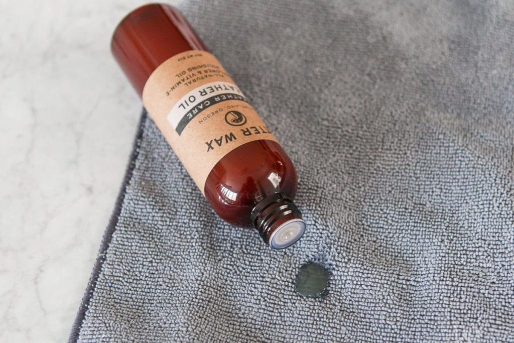 Put a small amount of the leather oil onto a clean cloth