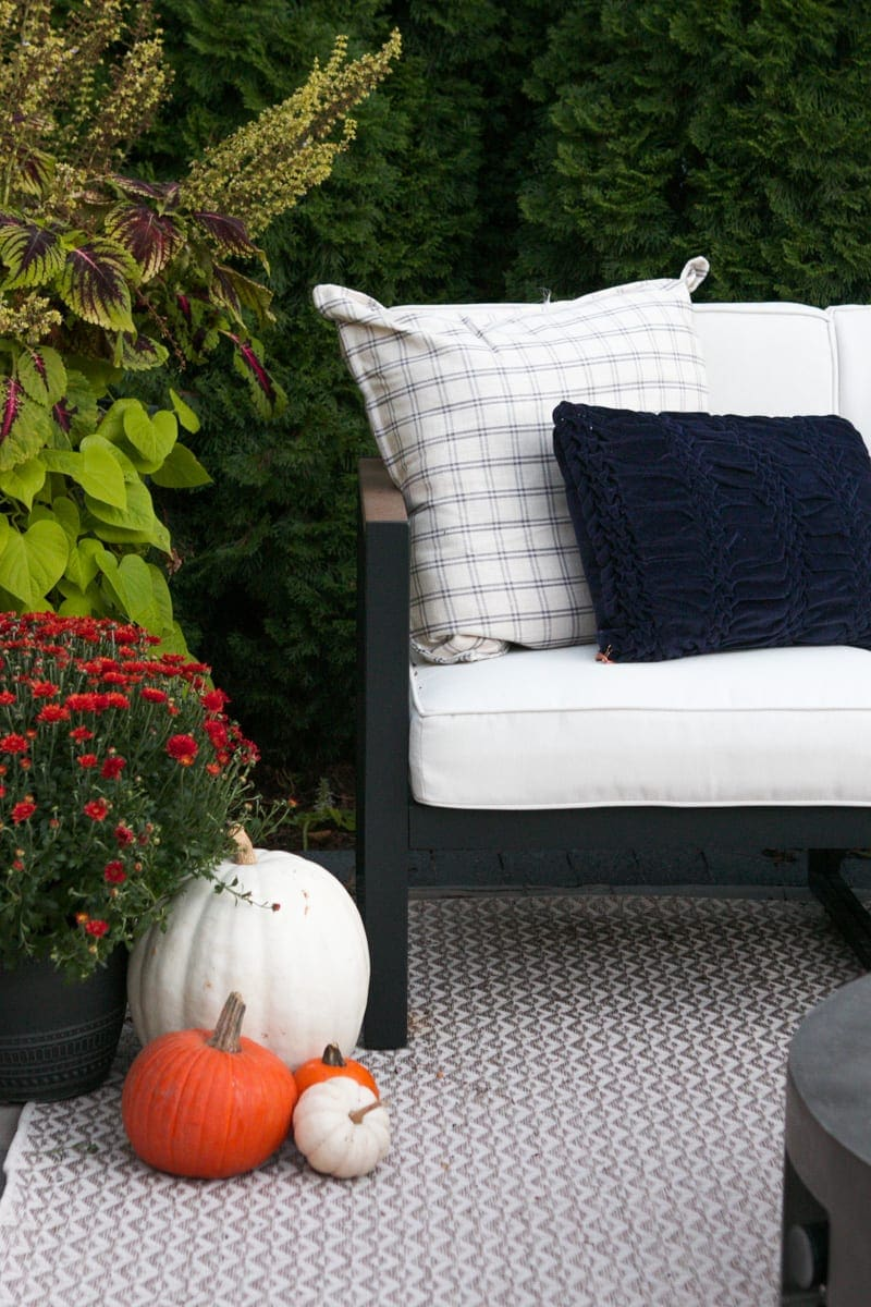 adding pillows to a fall outdoot patio