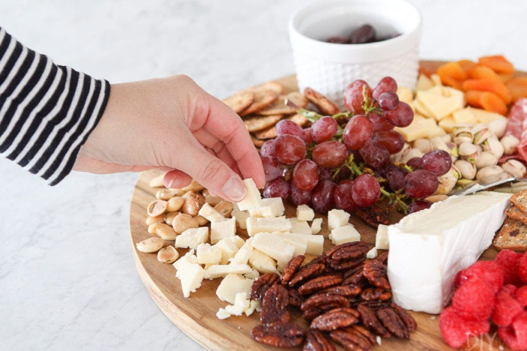 Eating cheese from a simple charcuterie board