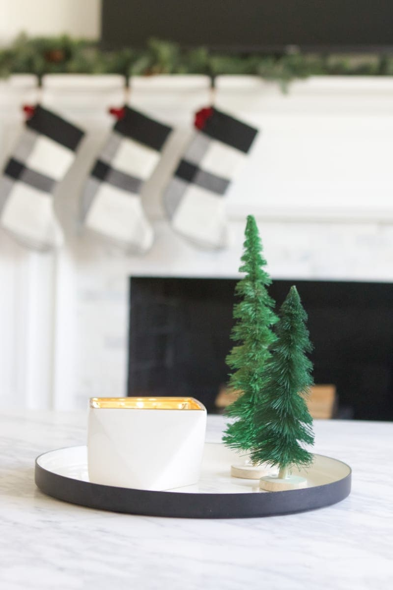 candle and christmas trees on a tray