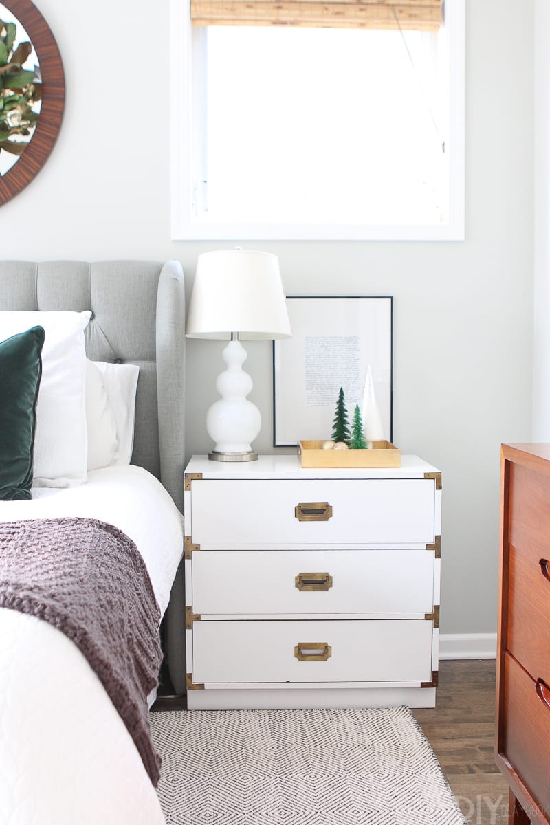 White nightstand with holiday decor