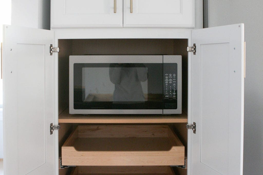 microwave inside of a pantry