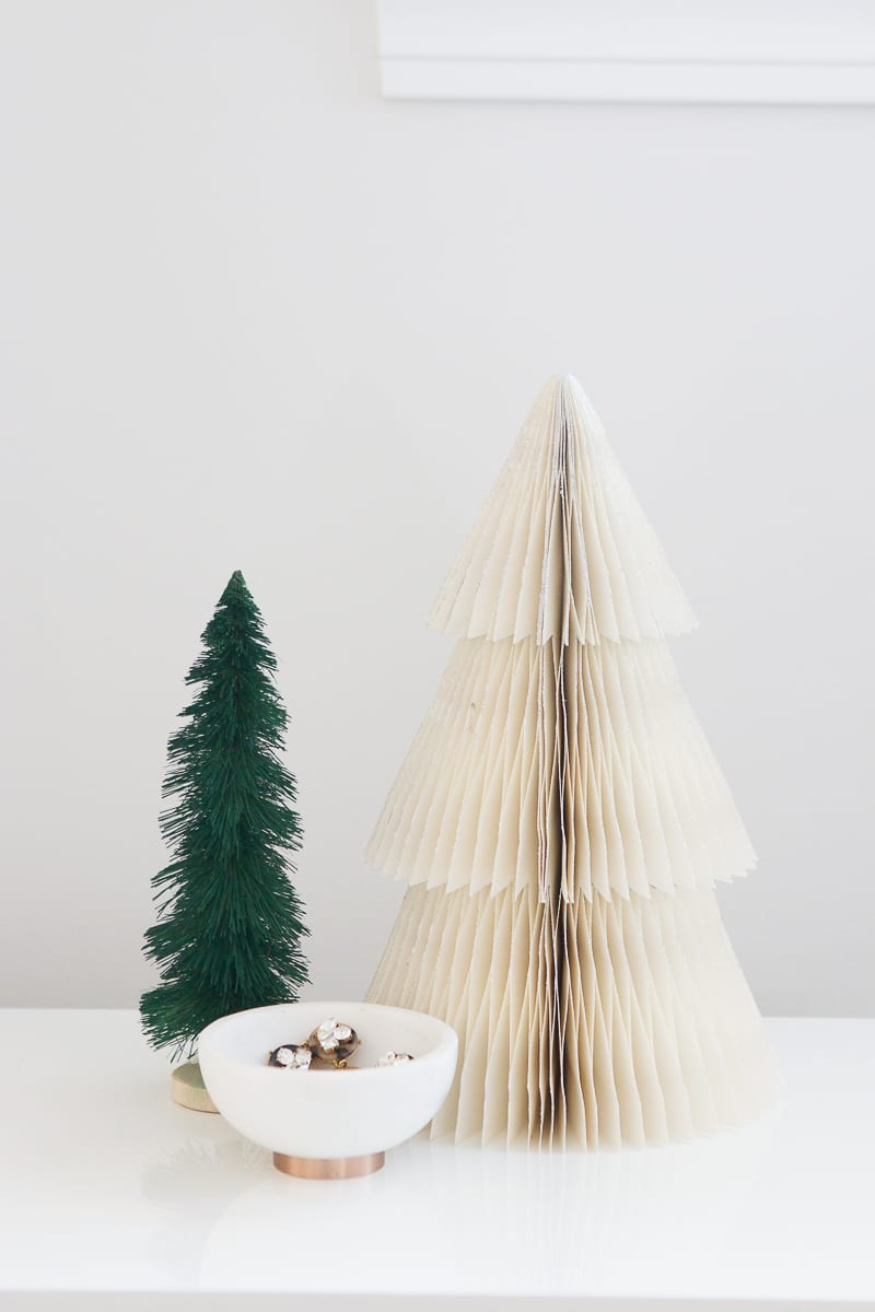 a foldable tree that makes packing old decorations so easy