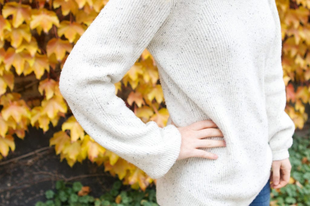 Bell sleeves on this neutral and cozy sweater