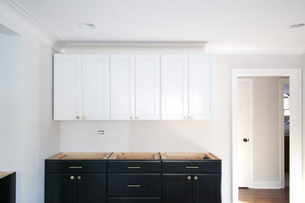white upper cabinets and black lower cabinets from Lowes