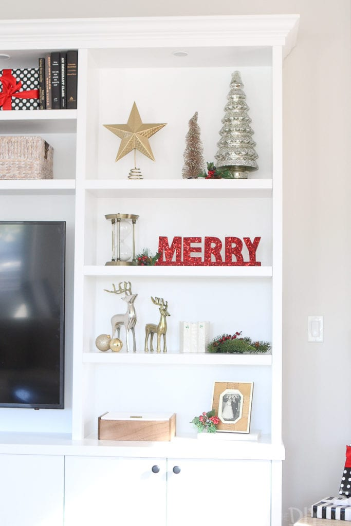 Add ornaments to your shelves for holiday decorating on a budget