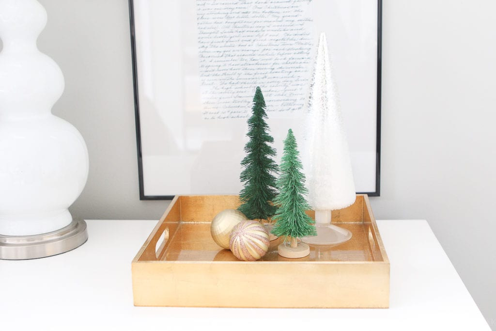 Gold tray with bottle brush trees