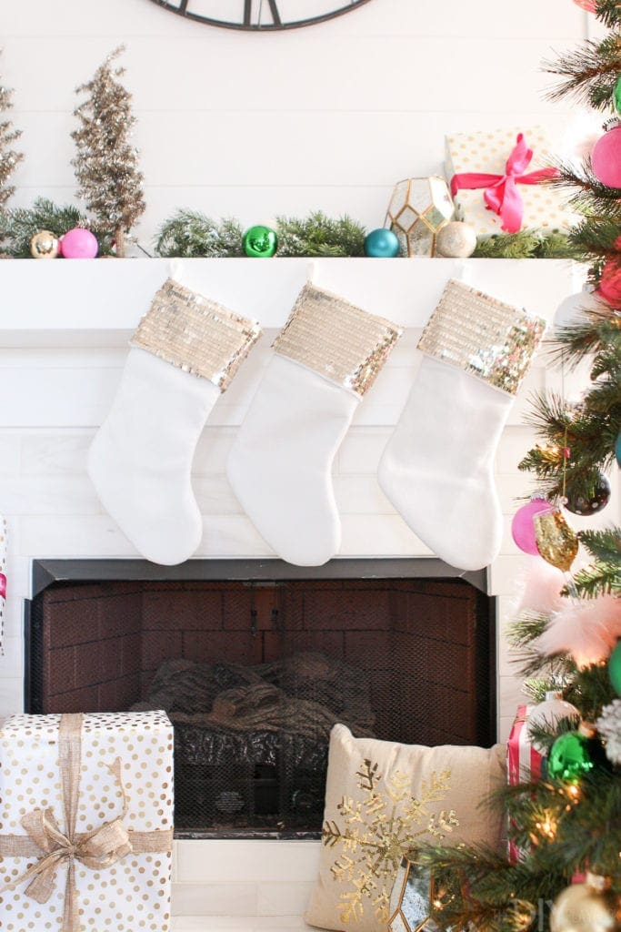 Gold sequined stockings on fireplace mantle