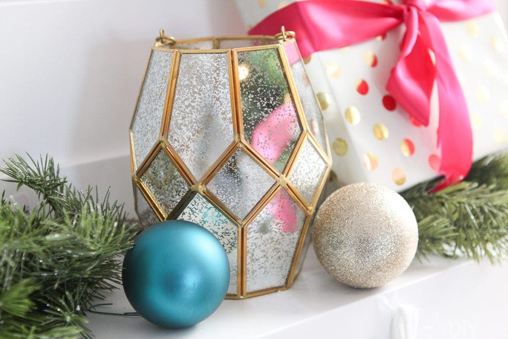 Gold lantern on a fireplace mantle for Christmas