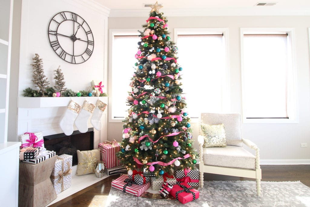 A colorful Christmas tree with pink and gold