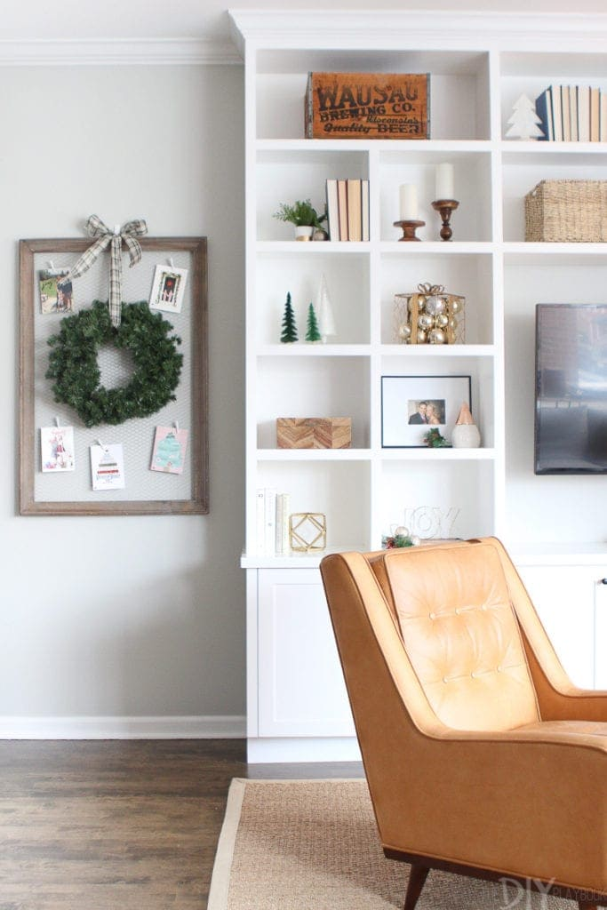 Christmas card display next to holiday built-in shelves