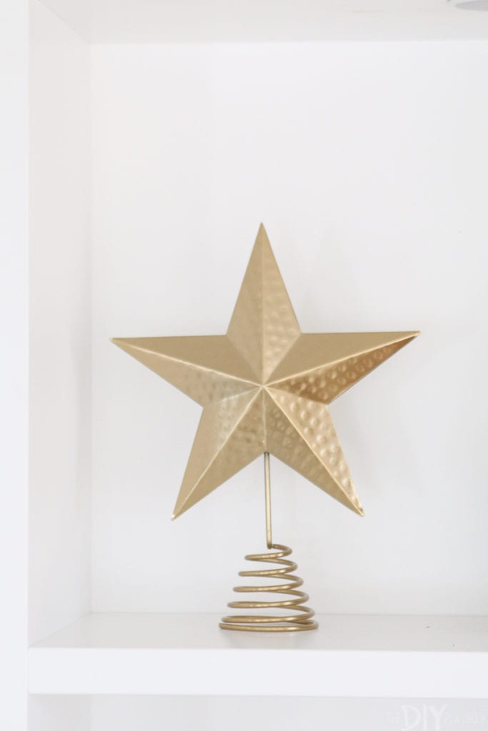 Gold tree topper as holiday decor