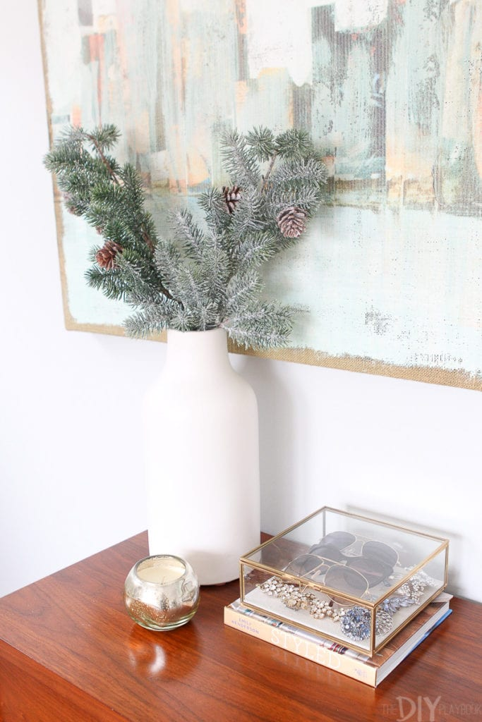 Use a tall white vase to hold holiday branches
