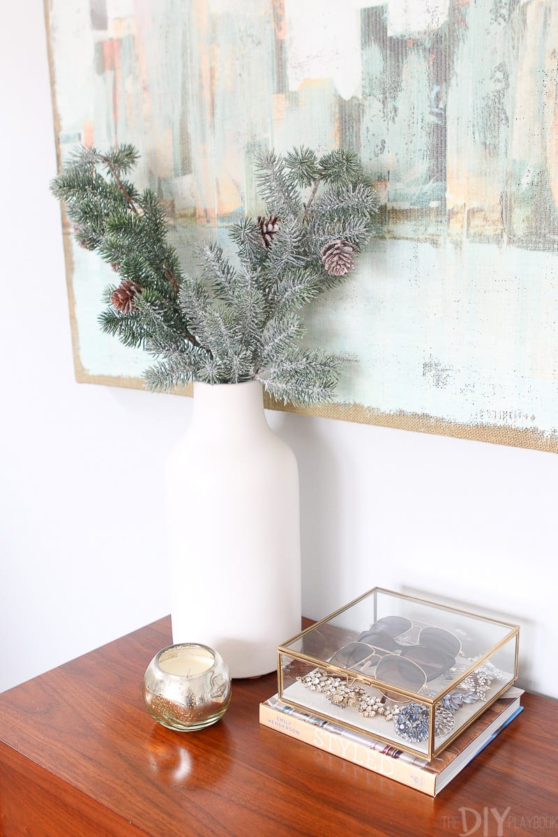 white vase with fresh greenery