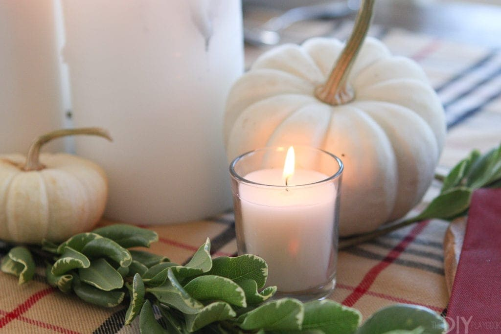 Add small candle votives to the simple Thanksgiving tablescape