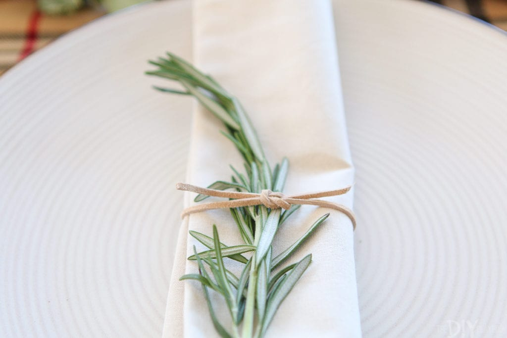 Tuck a sprig of rosemary into the napkins