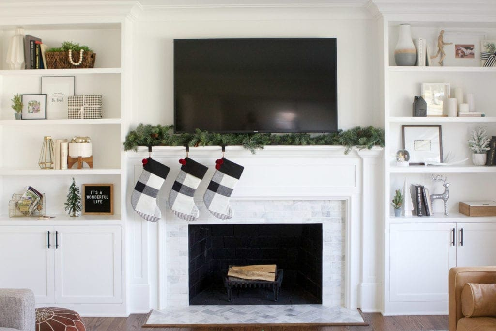decorating a fireplace mantel for Christmas