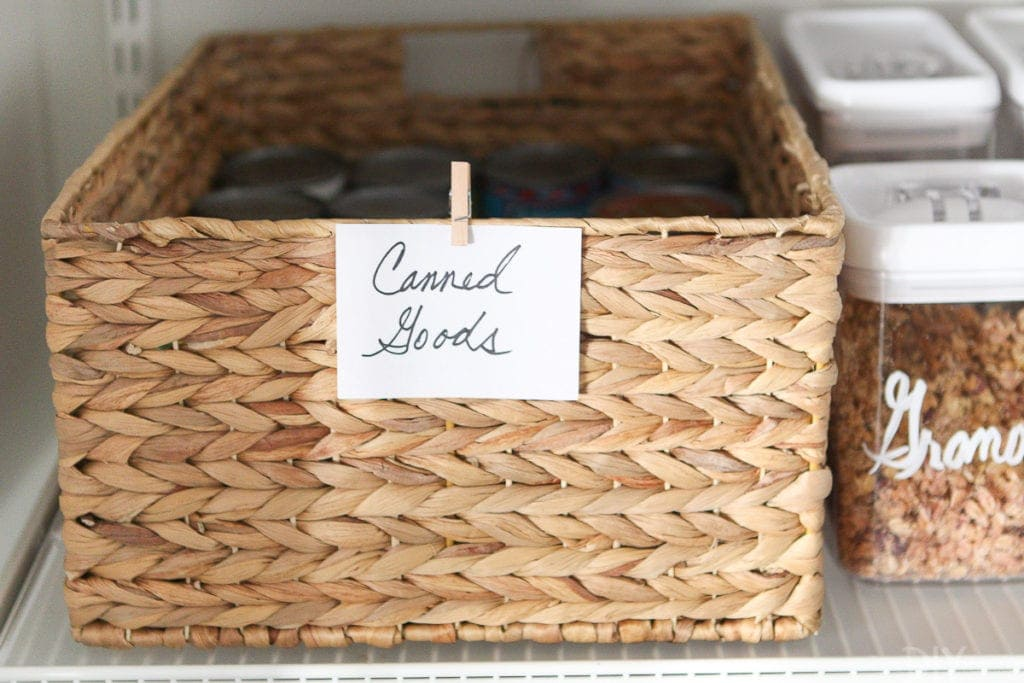 Use wicker baskets in a pantry to corral canned foods