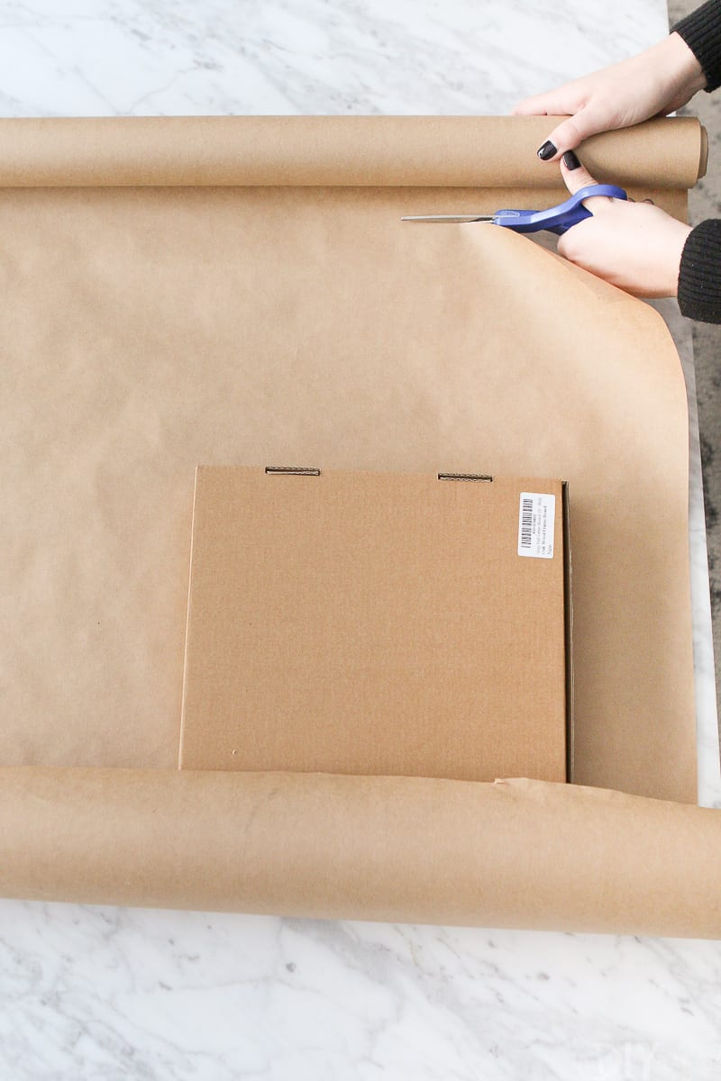 Cutting wrapping paper for a holiday gift