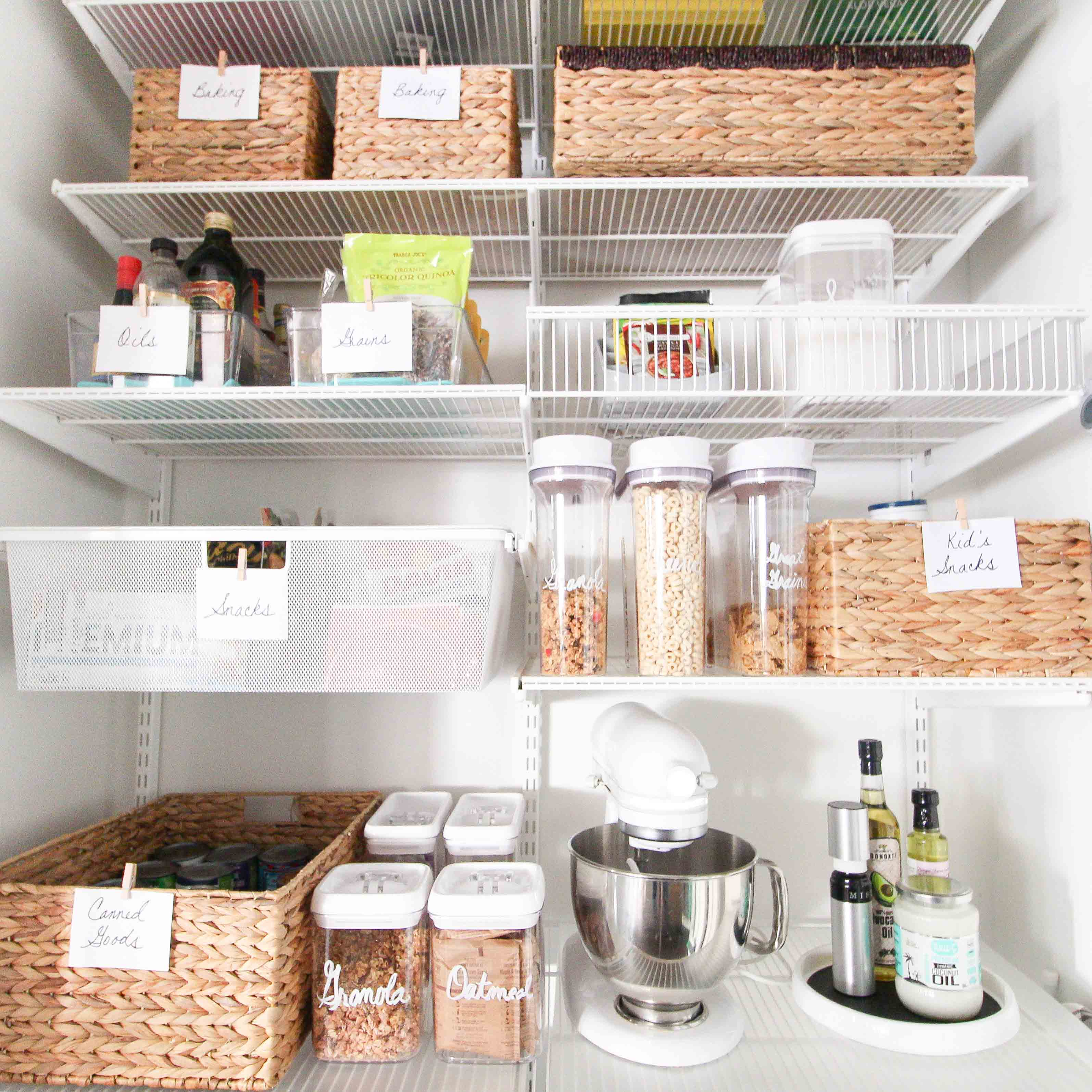 An organized pantry with wicker baskets