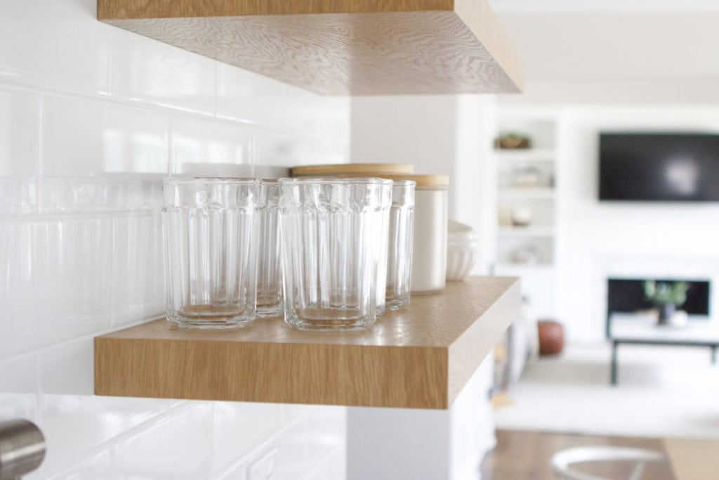 displaying glasses on kitchen open shelves