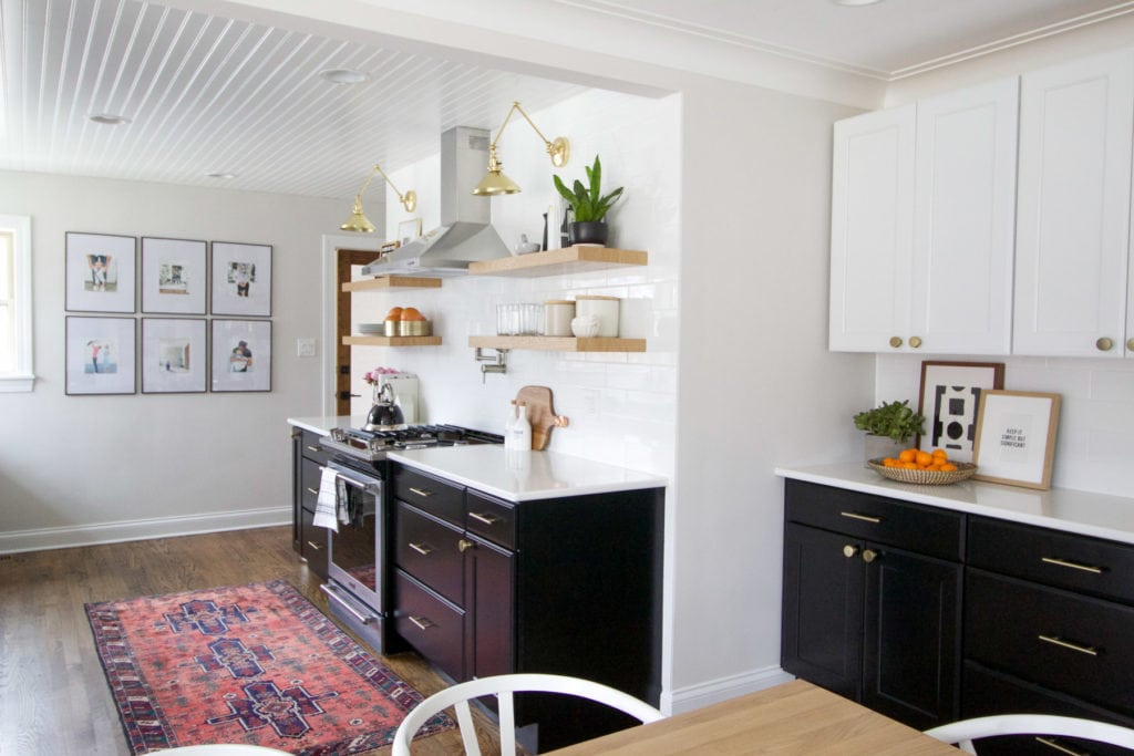 kitchen with black cabients and white uppers