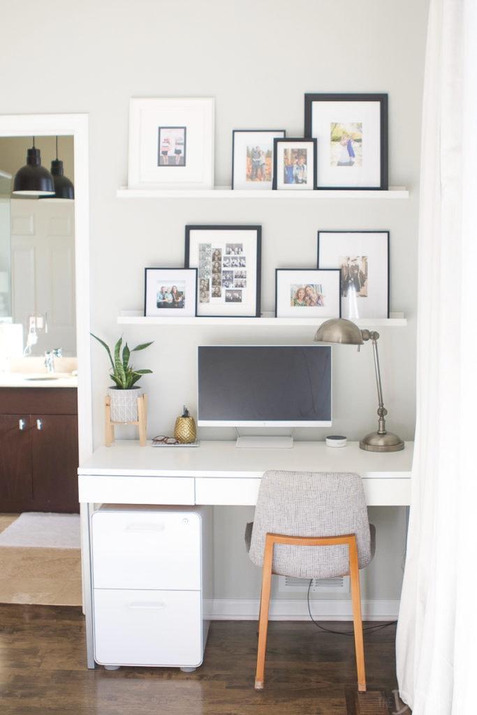 A white file cabinet under a slim desk area