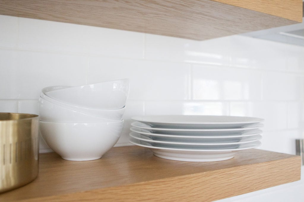 plates and dinnerware on kitchen shelves