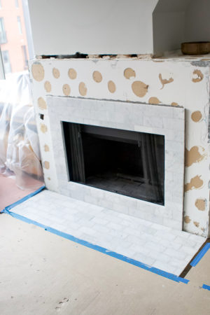 Fireplace makeover with marble subway tile
