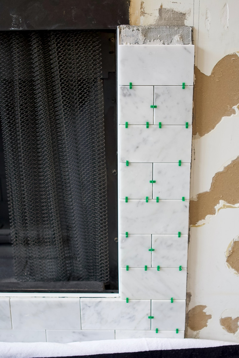 Adding marble subway tile to a fireplace surround