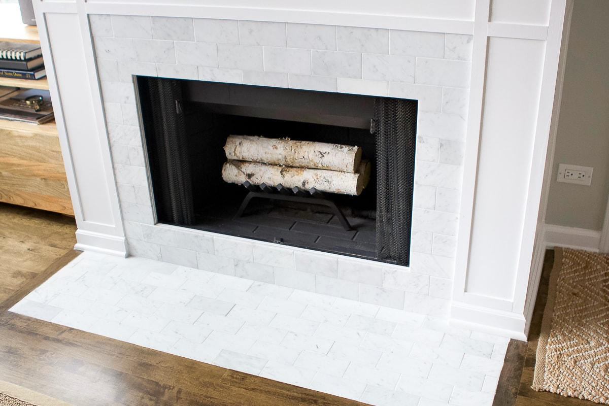 Marble subway tile on a fireplace