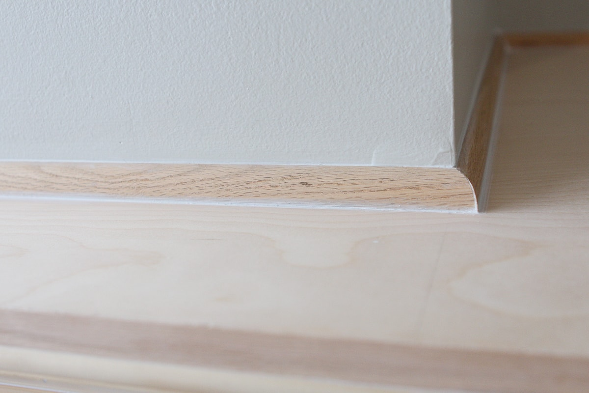 Shoe molding to hide gaps on fireplace woodworking