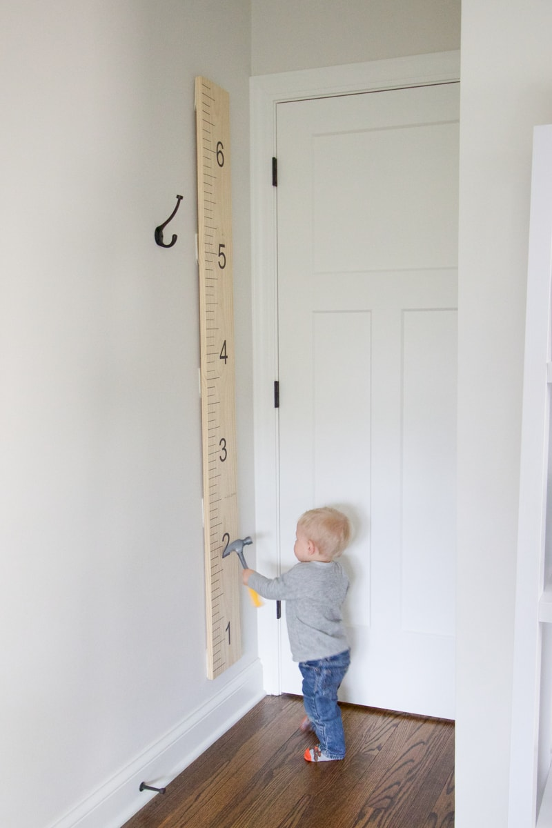 Ben measuring height with growth chart
