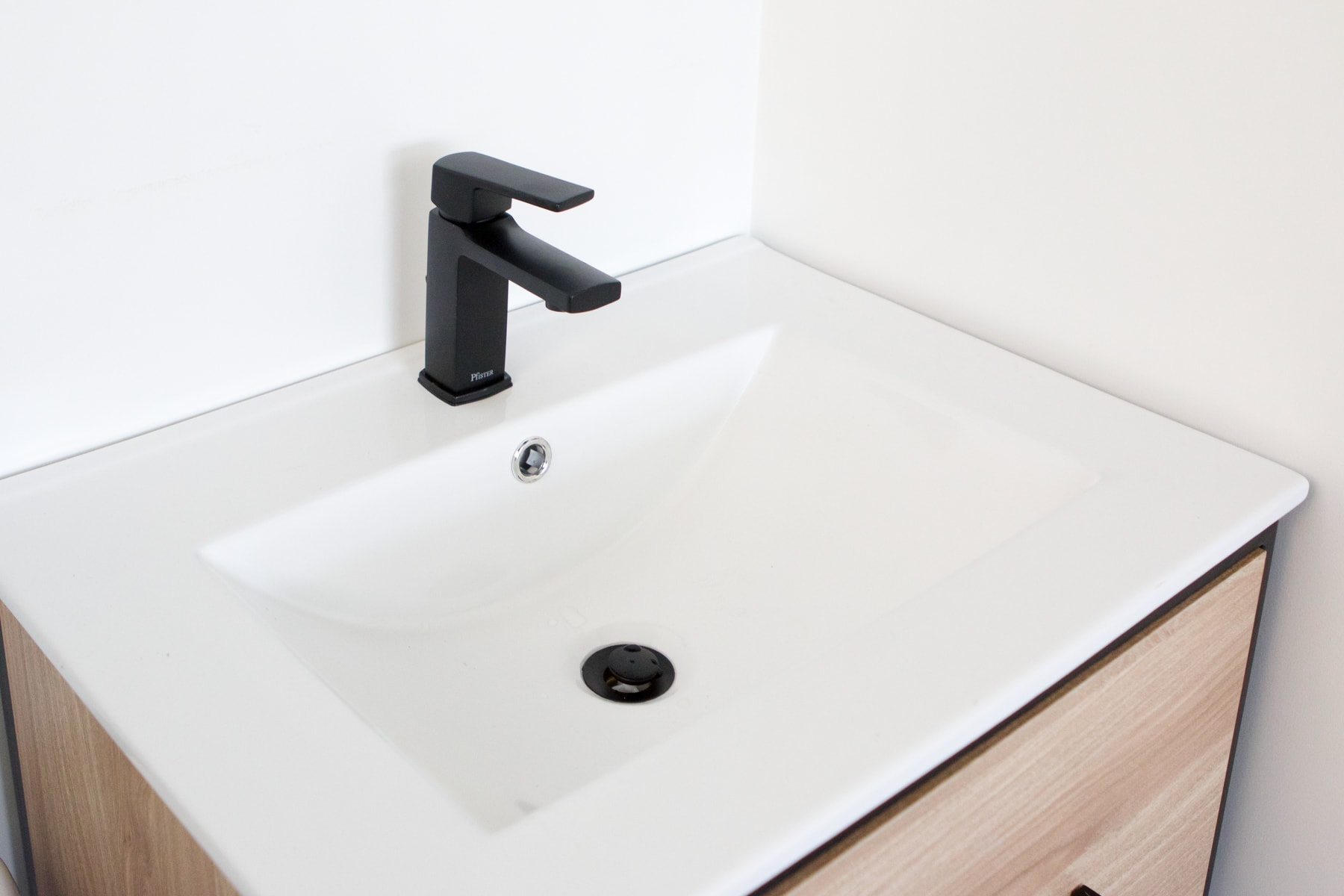 black faucet with black drain