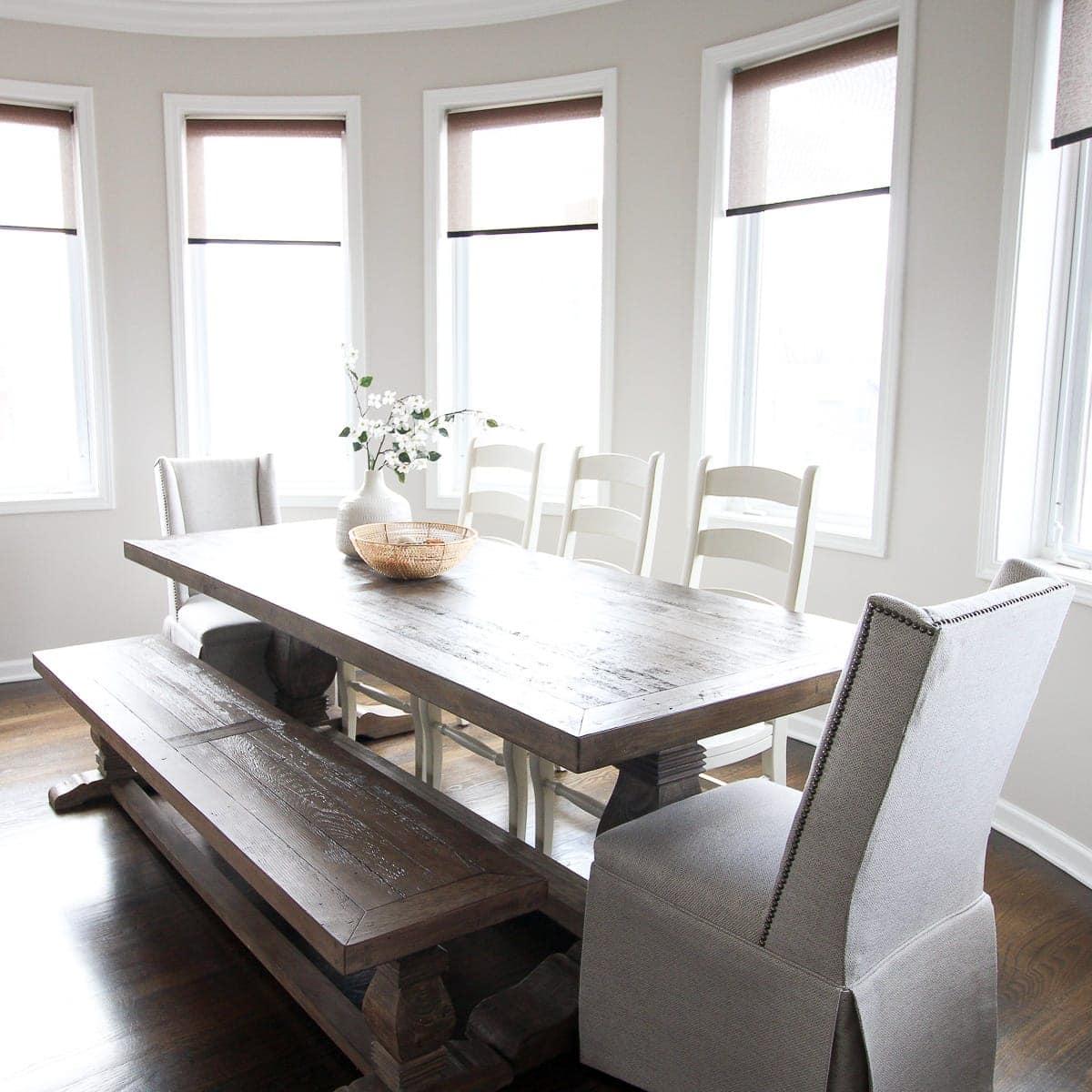 Farmhouse dining room in a feminine home tour