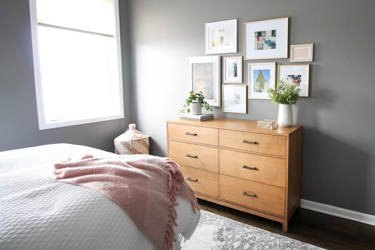 Wood dresser in a gray bedroom