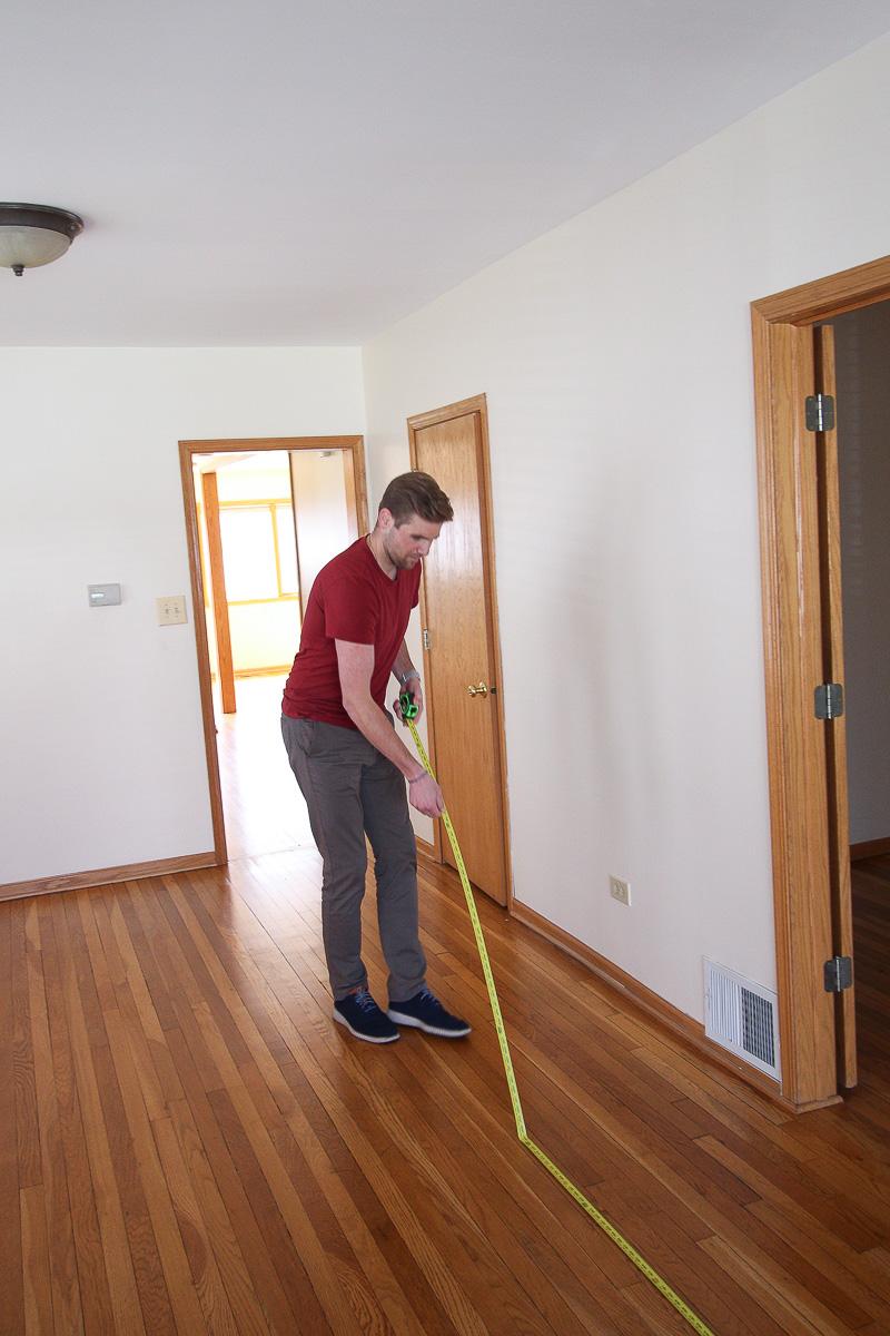 Finn measuring the family room