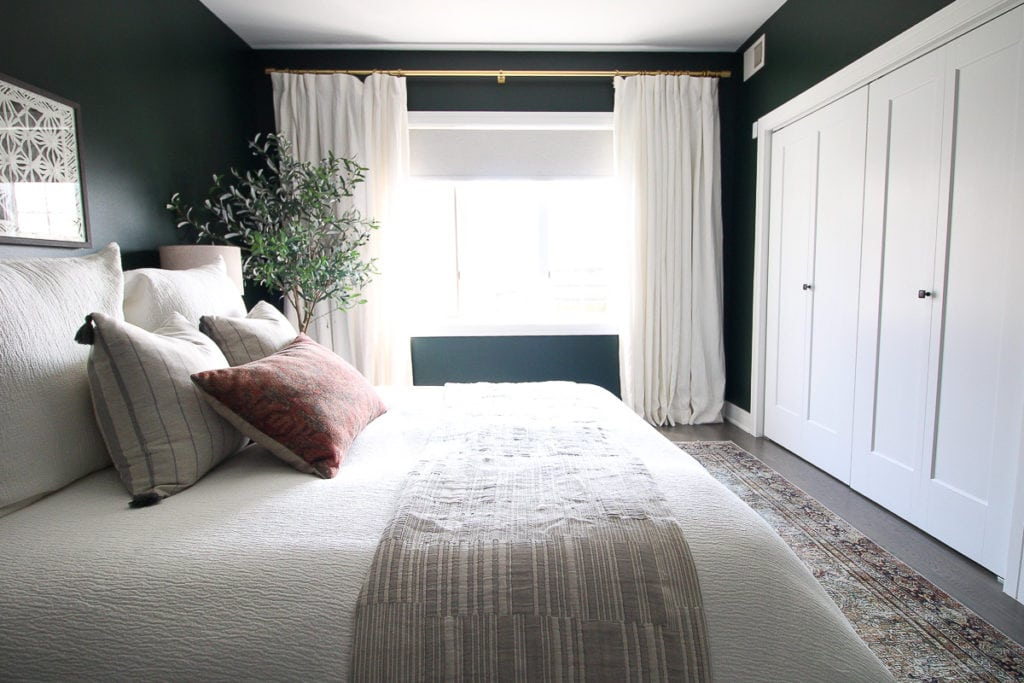 Dark green guest room reveal with white curtains